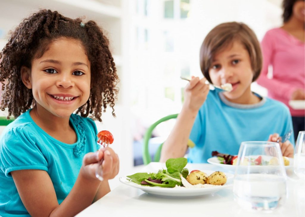 young-girl-eating-healthy-1024x731
